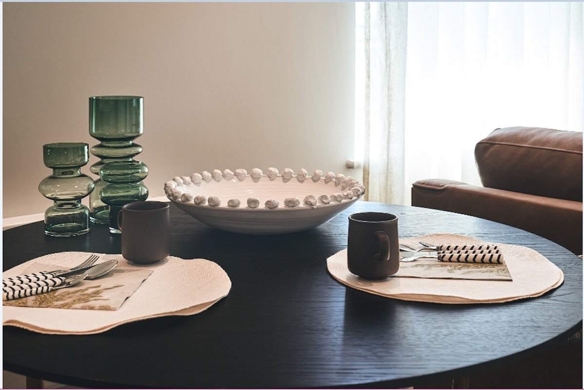 Dressed dining table for a holiday let | Manor Interiors