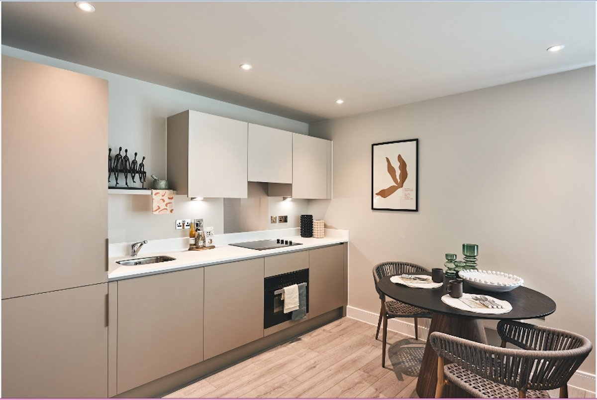 Kitchen and dressed dining table with accessories in a serviced apartment | Manor Interiors